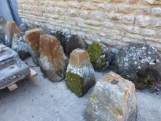 A GROUP OF SEVEN 19th.C.STADDLE STONES WITH TOPS.