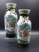 A PAIR OF CHINESE FAMILLE ROSE WARRIOR DECORATED CRACKLE GLAZE VASES WITH APPLIED DRAGON COLLARS AND