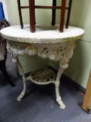 AN ANTIQUE CAST IRON GARDEN TABLE WITH MARBLE TOP. Dia.68 x H.76cms.