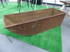 A CAST IRON SCOOP FORM FEED TROUGH.