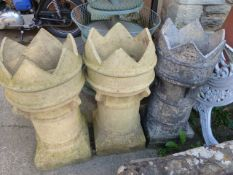 THREE CASTELLATED TOP CHIMNEY POTS AND ONE OTHER.