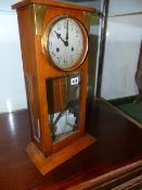 AN EARLY 20th.C.GERMAN MANTLE CLOCK IN ARTS AND CRAFTS STYLE, THE WALNUT CASE WITH GLAZED PANELS AND