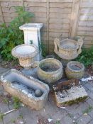 A BOOT SCRAPER, AN ANTIQUE SMALL MORTAR AND VARIOUS DECORATIVE GARDEN URNS AND PLANTERS.
