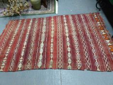 A TRIBAL FLAT WEAVE RUG. 298 x 170cms AND ANOTHER. 162 x 63cms. (2)