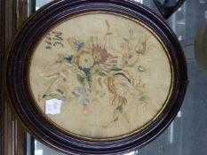 A PAIR OF GILT FRAMED OVAL GEORGIAN SILKWORK FLORAL PANELS. 23 x 16cms TOGETHER WITH A LARGER