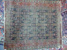 AN ANTIQUE PERSIAN FEREGHAN MAT. 91 x 78cms TOGETHER WITH AN ANTIQUE TURKISH MAT.