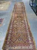AN ANTIQUE PERSIAN SERAB RUNNER. 500 x 111cms