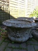 TWO PAIRS OF LARGE GARDEN URNS ON SHAPED PEDESTAL SUPPORTS.