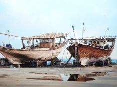 SUE CASSON. (20th/21st.C.) (ARR) BEACHED DHOWS, A SIGNED OIL ON CANVAS. PROV.MATHAF GALLERY LTD.