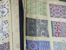 AN UNUSUAL VINTAGE EARLY TO MID 20th.C.LARGE BOUND VOLUME OF FABRIC DESIGN SAMPLES CONTAINING HUNDRE