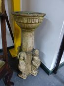 AN ANTIQUE COMPTON TYPE POTTERY PEDESTAL SUNDIAL DECORATED WITH FIGURES DEPICTING THE SEASONS.
