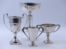 A GROUP OF THREE SILVER ENGRAVED PRESENTATION TROPHY CUPS, ONE BEARING A CHESTER HALLMARK, DATED