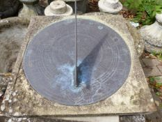 A GARDEN SUNDIAL ON COLUMN SUPPORT.