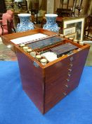 A MID 20th.C.MAHOGANY CASED DENTIST CABINET WITH RISING LID AND SIX GRADUATED DRAWERS ALL FULLY