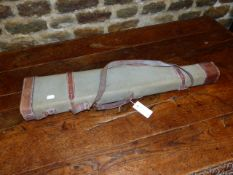 A PIGSKIN LEATHER LEG O'MUTTON GUN CASE TOGETHER WITH A CANVAS EXAMPLE. (2)
