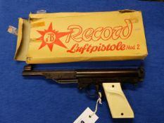 A .22 BOXED RECORD AIR PISTOL MOD.2, TWO PIECE WHITE PLASTIC GRIPS.