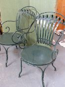 A PAIR OF FRANCOIS CARRE SPRUNG BACK GARDEN OR CAFE ARMCHAIRS.