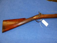 AN 19TH.C. PERCUSSION RIFLE WITH DAMASCUS OCTAGONAL BARREL AND SET TRIGGER