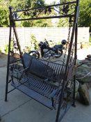 A METAL GARDEN SWING SEAT. W.156cms.