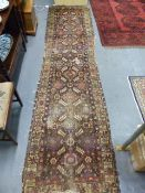 AN ANTIQUE PERSIAN TRIBAL RUNNER. 366 x 92cms.
