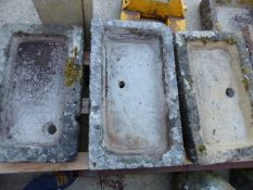 THREE ANTIQUE SHALLOW CARVED STONE SINKS. LARGEST, 78 x 46cms.