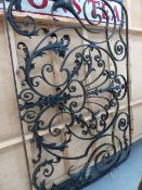 A VICTORIAN WROUGHT IRON WINDOW GRILLE WITH LEAF DECORATION.