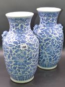 A PAIR OF CHINESE BLUE AND WHITE BALUSTER VASES WITH APPLIED MASK HANDLES AND SCROLLING FOLIATE