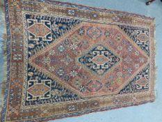 AN ANTIQUE PERSIAN QASHQAI RUG. 192 x 125cms.