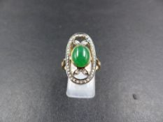A DIAMOND AND CABOCHON OVAL GEMSTONE ELONGATED RING, TESTS AS GOLD, FINGER SIZE O. WEIGHT 5grms.