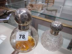 TWO SILVER MOUNTED SPHERICAL CLEAR GLASS SCENT BOTTLES, MARTIN & HALL, CHESTER 1909 AND A WORN