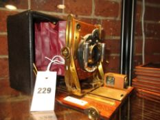 A VINTAGE 1/4 PLATE CAMERA SANDERSONS PATENT FITTED BAUSCH & LOMB SHUTTER AND GOERTZ LENS COMPLETE