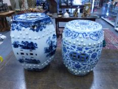A CHINESE BLUE AND WHITE BARREL FROM GARDEN SEAT WITH SCROLLING FOLIATE AND FLOWER HEAD
