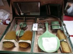 A GREEN GUILLOCHE ENAMEL AND SILVER HALLMARKED THIRTEEN PIECE FITTED TRAVEL DRESSING TABLE SET TO