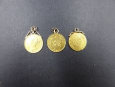 THREE 22ct GOLD COINS, TO INCLUDE A GEO.III HALF SOVEREIGN, AN 1883 VICTORIA SHIELD BACK HALF