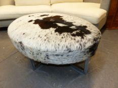 A 20th.C.LARGE OVAL STOOL WITH CHROME FRAME AND COW HIDE UPHOLSTERY. 110 x 82 x H.48cms.