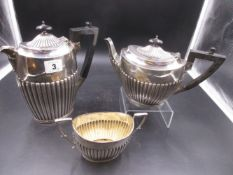 A SILVER PART TEA SET COMPRISING OF A HOT WATER POT, TEA POT AND TWO HANDLED SUGAR BOWL DATED 1920
