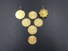 A 1793 GEO.IV FIXED PENDANT SPADE GUINEA TOGETHER WITH FOUR FULL SOVEREIGNS DATED 1898,1900,1905,