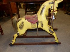 AN EARLY 20th.C.CARVED PINE ROCKING HORSE ON TRESTLE BASE. HOOF TO EAR. 76cms.