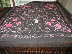 A LATE 19th/EARLY 20th.C.CHINESE BLACK SILK SHAWL EMBROIDERED WITH COLOURED FLOWERS.