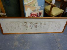 A FRAMED EDWARDIAN LINEN AND SILKWORK PANEL OF FIVE CHILDREN WITHIN A FLORAL SCROLLWORK, FRAMED.