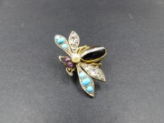 A VICTORIAN GEMSET INSECT BROOCH. THE BODY IS AN OVAL BANDED AGATE CABOCHON, WITH ONE PAIR OF OLD