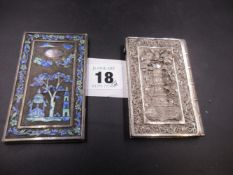 A LATE 19th.C.SILVER AND MULTI ENAMEL CARD CASE TOGETHER WITH A CHINESE FILIGREE CARD CASE WITH