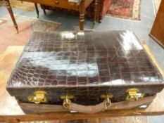 AN EARLY 20th.C.CROCODILE HIDE DRESSING CASE WITH ORIGINAL CANVAS OUTER.