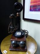 A VINTAGE CANDLESTICK TELEPHONE WITH WALL MOUNTED BELL BOX.