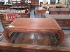 A CARVED HARDWOOD CHINESE LOW TABLE WITH INCURVED LEGS. W.92cms.