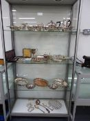 A COLLECTION OF SILVER PLATE TO INCLUDE TEAWARES, SAUCE BOATS, SERVING DISHES, BERRY SPOONS,ETC. (
