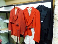 TWO VINTAGE HUNTING PINKS TAIL COATS, A BLACK TAIL COAT AND TROUSER, TWO VINTAGE RIDING HATS AND A