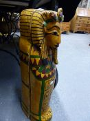 A CARVED WOOD AND POLYCHROME EGYPTIAN MUMMY CASE WITH INTERNAL FIGURE. L.64cms.