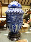 A LARGE GERMAN BLUE POTTERY LAMP BASE ON WOODEN SOCLE. H.60cms.