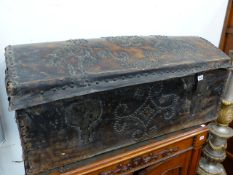 AN EARLY NAILED AND STUDDED LEATHER COVERED DOME TOP TRUNK WITH CARRYING HANDLES. W.107cms.